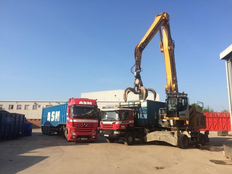 ASM lorries parked beside grab machine