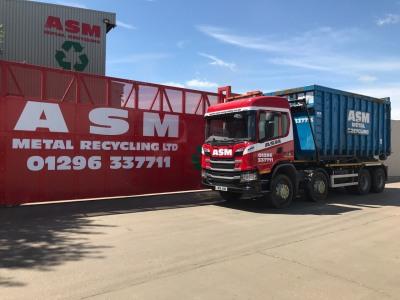 ASM roll-on-roll-off scrap metal truck against Aylesbury entrance