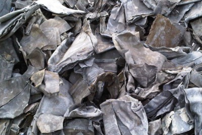Close-up on container of scrap lead metal